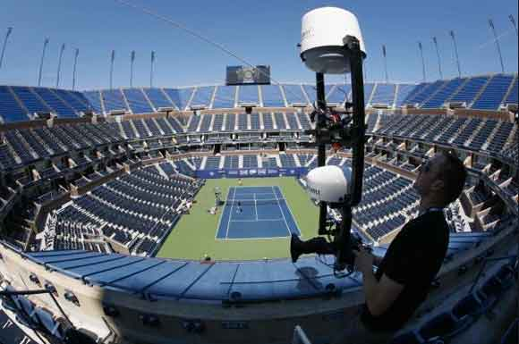 Photo credit: AP | Steve Mayer, of Austria, sets up an overhead camera at Arthur Ashe Stadium. (Aug. 28, 2010)