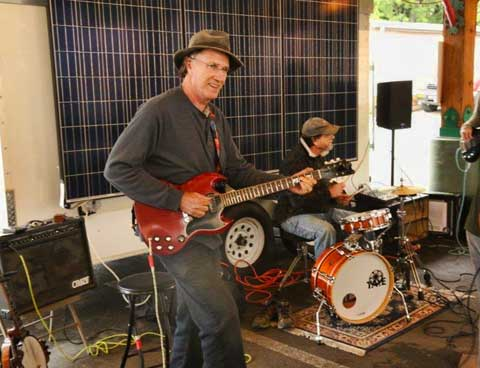 Musicians play powered by the SustainFloyd Solar Voltzwagon.